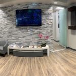 Wide shot of our lobby and front area with comfortable seating and large screen TV.
